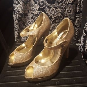 Gold heeled open toe shoes